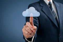 Cloud computing. Concept. Man click on cloud icon ahead. Selective focused on finger Royalty Free Stock Photos