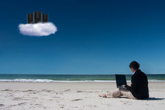 Cloud computing on beach with laptop Royalty Free Stock Photos