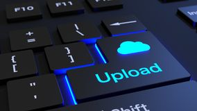 Cloud computing black keyboard upload button. Black keyboard where the enter key is glowing blue showing the word upload and a cloud symbol cloud computing Stock Photos