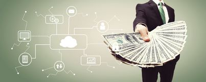 Cloud Computing with business man with cash. Cloud Computing with business man displaying a spread of cash royalty free stock photos