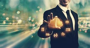 Cloud Computing with businessman. On blue tech background stock photography