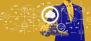 Cloud computing with businessman in duotone. Cloud computing with businessman in a yellow and blue duotone stock photo
