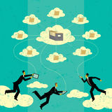 Cloud computing. Businessmen connecting to cloud storage via their mobile devices. The men and storage clouds are on a separate labeled layer from the background Royalty Free Stock Photography