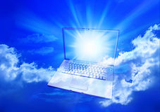 Cloud Computing Computer. A laptop computer in a blue cloudy sky Royalty Free Stock Image