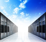 Cloud computing and computer networking concept. Server room interior on white reflective background Stock Image