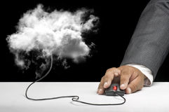 Cloud computing concept. A hand grabbing a mouse connected to a cloud