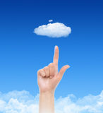 Cloud Computing Concept. Woman hand point on cloud against blue sky with clouds. Concept image on cloud computing and eco theme Royalty Free Stock Images