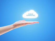 Cloud Computing Concept. Woman hand share the cloud against blue background. Concept image on cloud computing theme with copy space Stock Images