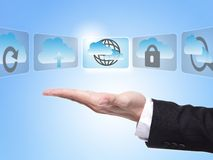 Cloud computing concept. Business man hand palm holding all kinds of icon about cloud computing with blue sky background Stock Photography