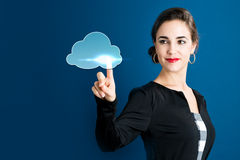 Cloud Computing concept with business woman. On a dark blue background Royalty Free Stock Image