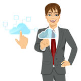 Cloud computing concept businessman touching the icon Stock Photography