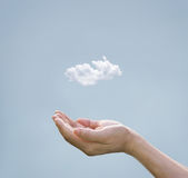 Cloud computing concept, cloud above hand of businessman. On pastel background Stock Photography