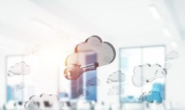 Cloud computing concept with glass symbol shown in air. Mixed me. Glass cloud icon as concept for cloud computing on interior background. Mixed media stock images