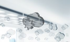 Cloud computing concept with glass symbol shown in air. Mixed media. Glass cloud icon as concept for cloud computing on interior background. Mixed media royalty free stock photos