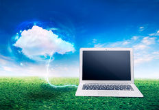 Cloud computing concept with laptop on grass Stock Images