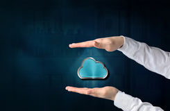 Cloud computing concept. Protecting gesture of businessman and s. Ymbol of a cloud and business background. connect to cloud royalty free stock images