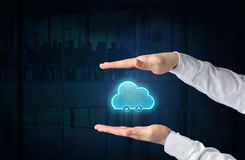 Cloud computing concept. Protecting gesture of businessman and s. Ymbol of a cloud and business background. connect to cloud stock photography