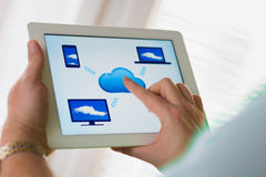Cloud computing concept and tablet. Man touching the cloud computing icon on a digital tablet computer Stock Photo