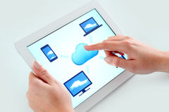 Cloud computing concept and tablet. Woman touching the cloud computing icon on a digital tablet computer Stock Images