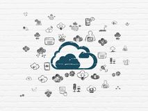 Cloud computing concept: Cloud on wall background. Cloud computing concept: Painted blue Cloud icon on White Brick wall background with  Hand Drawn Cloud Stock Photo