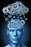 Cloud computing and education. Symbol represented by a human head shape with gears and cogs representing the concept of intellectual teaching being transferred Stock Photos