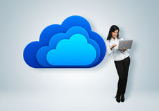 Cloud computing idea concept. Businesswoman stands by the cloud stock image