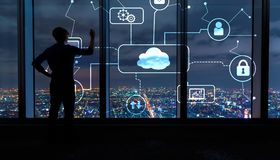 Cloud computing with man by large windows at night. Cloud computing with man writing on large windows high above a sprawling city at night stock photography