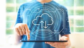 Cloud computing with man using a tablet stock photography