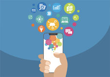 Cloud computing and mobility concept as  illustration with hand holding modern bezel-free / frameless smartphone and icons Royalty Free Stock Photos