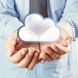 Cloud computing service. Cupped hands holding cloud symbol Royalty Free Stock Photos