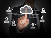 Cloud computing social network. Businessman touching cloud on virtual screen Stock Photo