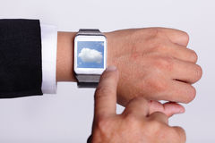 Cloud computing tech with smart watch Stock Photos