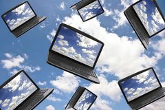 Cloud Computing Technology Concept. Laptop with a screen full of laptops in the clouds Royalty Free Stock Images