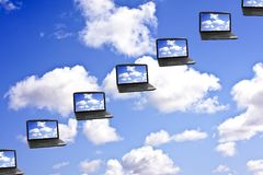 Cloud Computing Technology Concept. Laptops flying in the clouds Royalty Free Stock Images