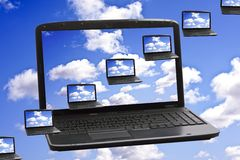Cloud Computing Technology Concept. Laptops flying in the clouds Royalty Free Stock Photo