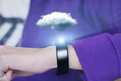 Cloud computing technology with smart wristband. A smart wristband is a wearable computing device that closely resembles a wristwatch or other time-keeping Stock Photography