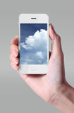 Cloud computing technology with smartphone and hand on grey back. Ground. Cloud computing is a general term for the delivery of hosted services over the Internet Royalty Free Stock Photo