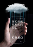 Cloud computing technology with smartphone. Cloud computing technology with hand and smartphone isolated on black background. Cloud computing is a general term Stock Photos
