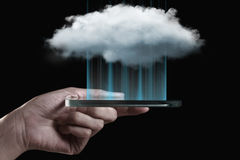 Cloud computing technology with smartphone. Cloud computing technology with hand and smartphone isolated on black background. Cloud computing is a general term Royalty Free Stock Photo