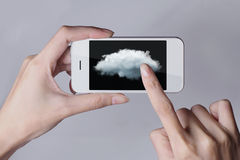 Cloud computing technology with smartphone and hands on grey bac. Kground. Cloud computing is a general term for the delivery of hosted services over the Royalty Free Stock Photography