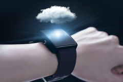 Cloud computing technology with smartwatch. A smartwatch is a wearable computing device that closely resembles a wristwatch or other time-keeping device Royalty Free Stock Photos