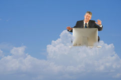 Cloud computing technology work storage icloud. A happy man is floating in the clouds with his computer which represents cloud computing and storage, icloud royalty free stock image