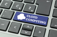 Cloud computing text and icon on a computer key Royalty Free Stock Photography