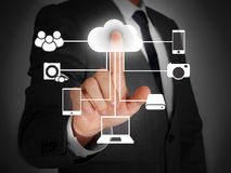 Cloud computing touch screen. Businessman touching cloud on virtual screen Royalty Free Stock Photography