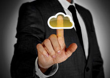 Cloud computing touch screen. Businessman touching cloud on virtual screen Stock Photos