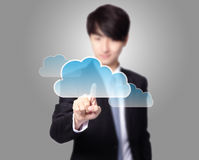 Cloud computing touchscreen interface. Futuristic display: Cloud computing touchscreen interface, business man finger touch cloud with gray background, asian Royalty Free Stock Photo