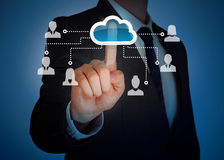 Cloud computing virtual screen. Businessman touching cloud on virtual screen Royalty Free Stock Photos