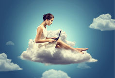 Cloud Computing. Woman with a Notebook working on a cloud Royalty Free Stock Photography