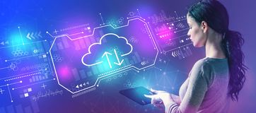 Cloud computing with woman using a tablet royalty free stock photos
