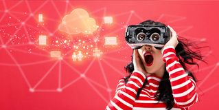 Cloud Computing with woman using a virtual reality headset Royalty Free Stock Photos
